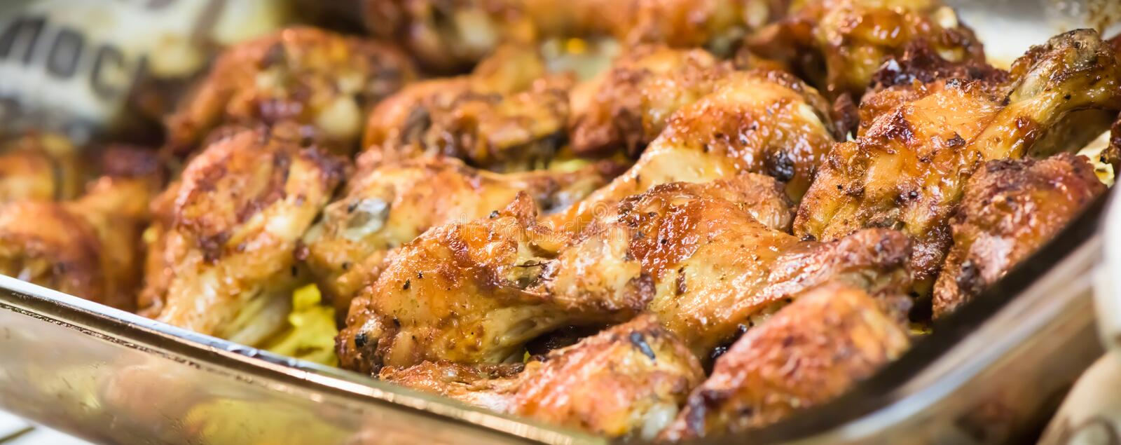 Roasted chicken wings - banner design - macro, closeup stock photography