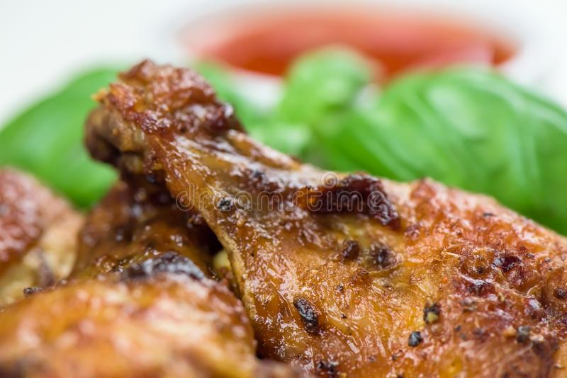 Roasted chicken wings - macro, closeup royalty free stock images