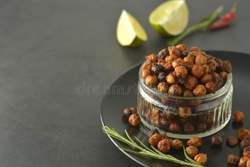 Roasted chickpeas. Crunchy, air fried delicious healthy food. Vegetarian food or lose weight snack royalty free stock images