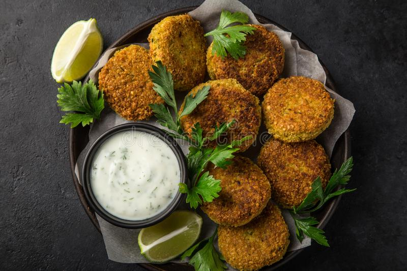 Roasted chickpeas falafel patties with garlic yogurt sauce royalty free stock photography