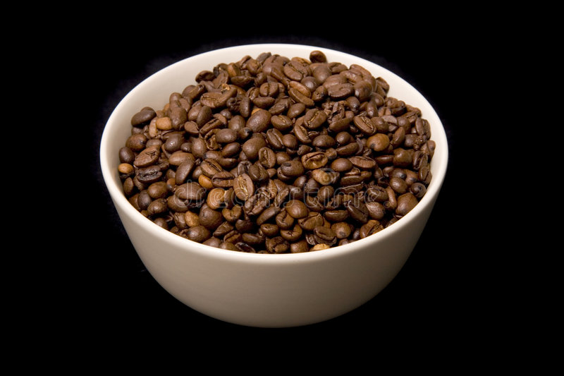 Roasted coffee beans in bowl stock images