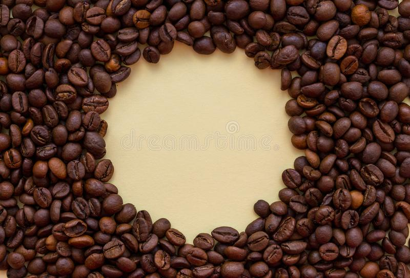 Roasted coffee beans with circle copy space in the middle. Aroma drink concept. Breakfast background. Coffee closeup with copy space. Cappuccino and espresso stock photos