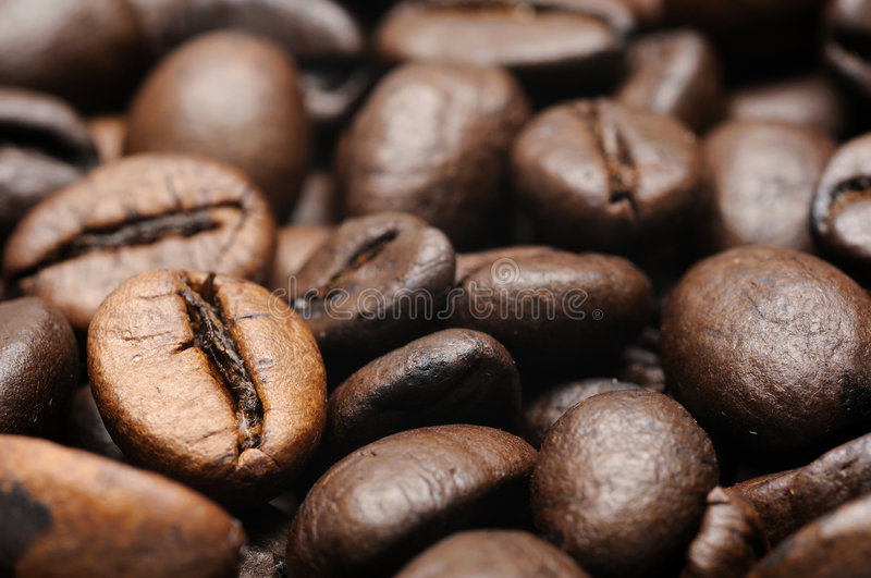 Roasted coffee beans closeup stock images
