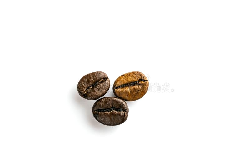 Roasted coffee beans for espresso, cappuccino isolated in white background royalty free stock photography