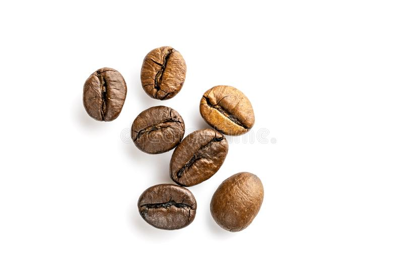 Roasted coffee beans for espresso, cappuccino on white background. royalty free stock photography