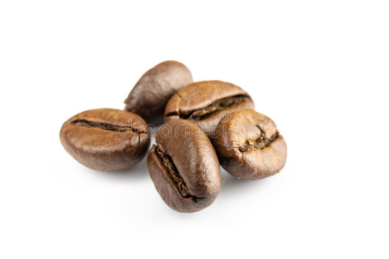 Roasted coffee beans isolated in white background cutout. Coffee background or texture concept. Roasted coffee beans for espresso, cappuccino isolated in white stock image
