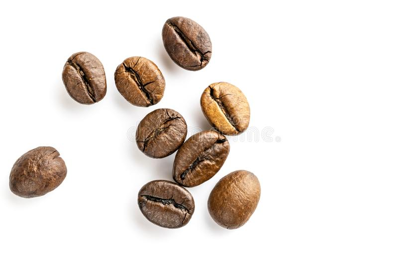 Roasted coffee beans for espresso, cappuccino on white background. royalty free stock photo