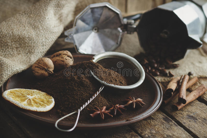Roasted coffee beans and ground coffee in the plate royalty free stock photos