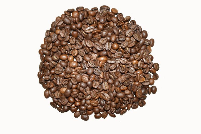 Roasted coffee beans isolated on a white background, coffee, aromatic food and drinks. Top view flat texture royalty free stock image