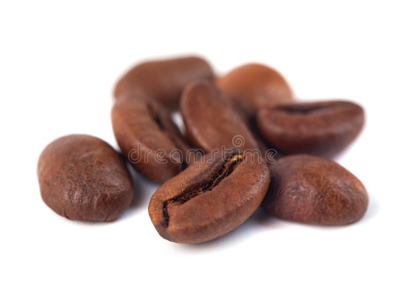 Roasted coffee beans isolated on white background. Three coffee. Beans stock photography