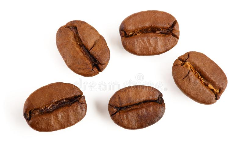 Roasted coffee beans isolated on white background. Top view. Flat lay.  stock image