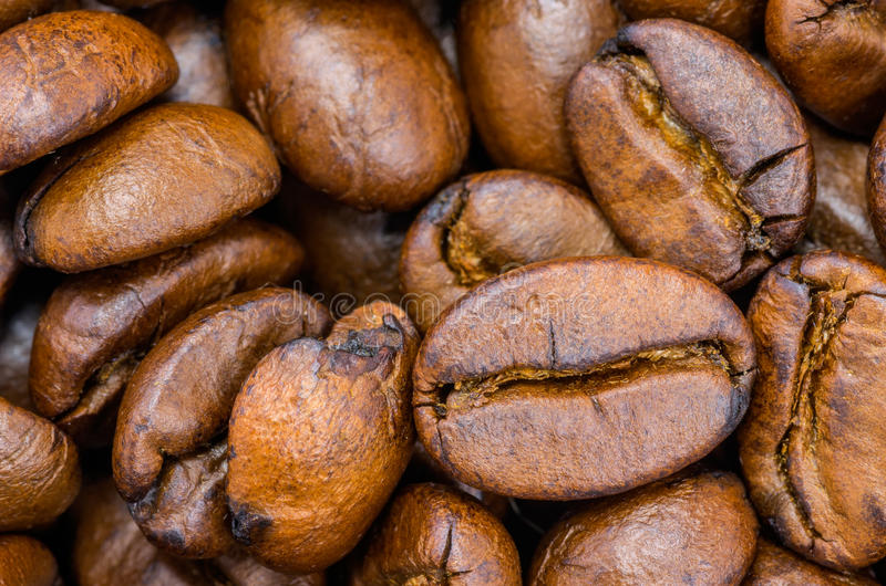 Roasted coffee beans. A lot of fresh roasted coffee beans for background stock photo