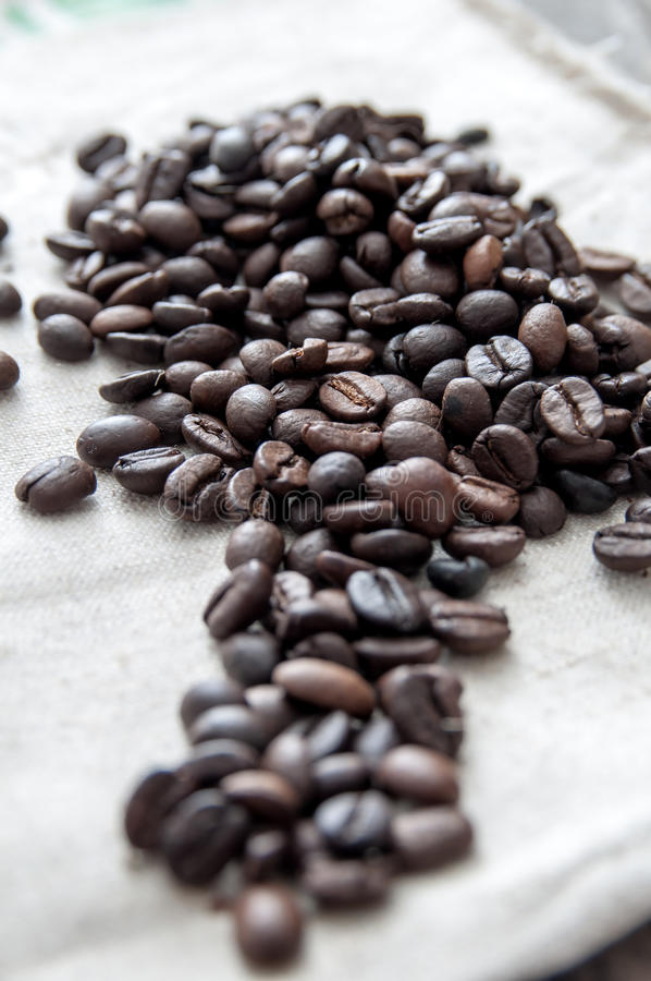 Roasted coffee beans over rustic background. stock images