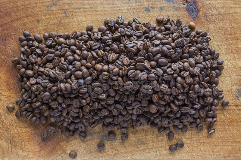 roasted coffee beans spread out royalty free stock image