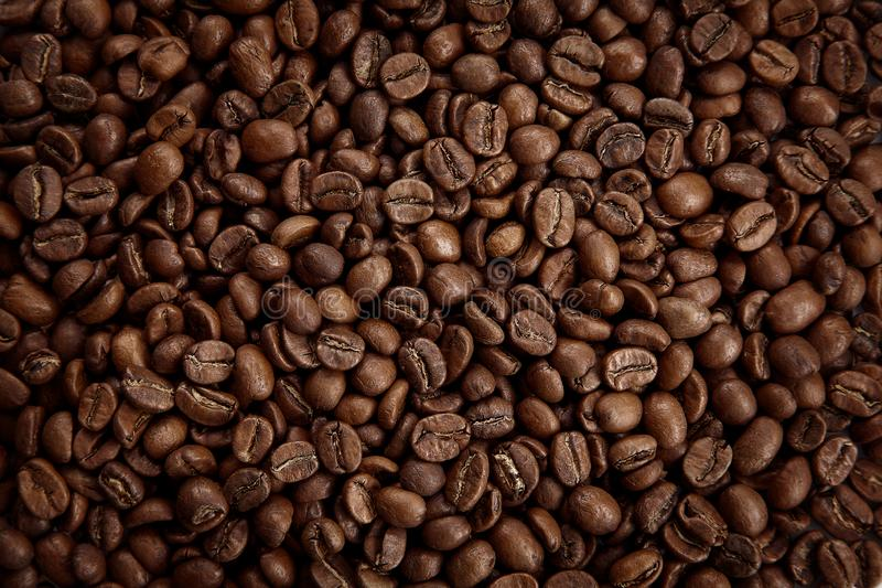 Roasted coffee beans texture. Close up view, top view stock images