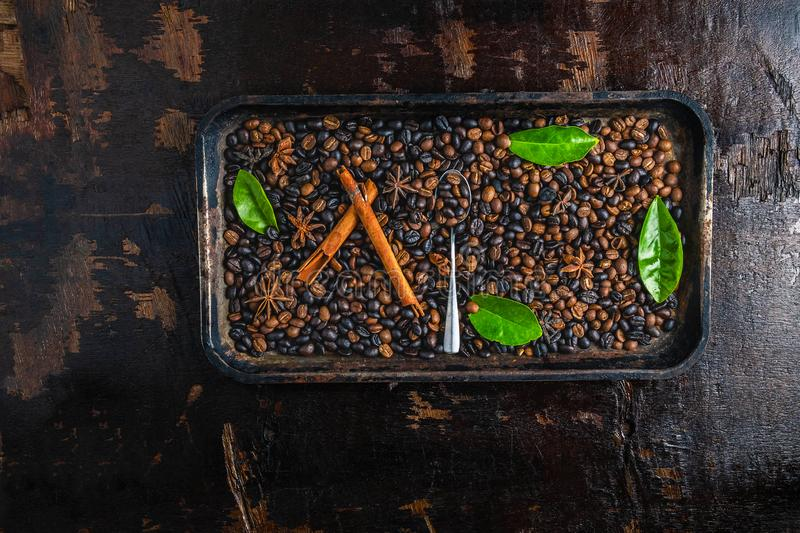 Roasted coffee beans in a tray. On wooden background royalty free stock photos