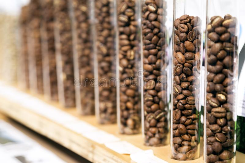 Roasted coffee beans. In tubes in a row royalty free stock photo