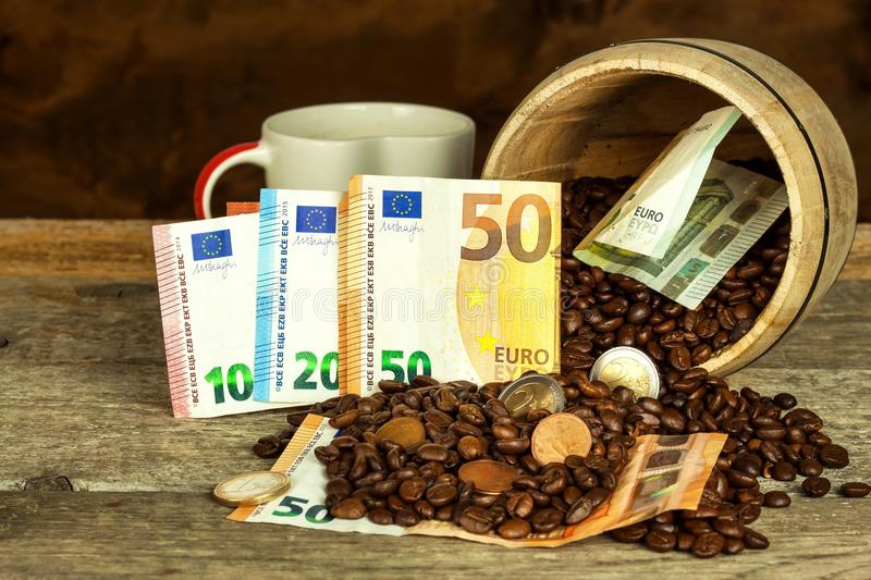 Roasted coffee beans and valid euro banknotes. Coffee trading. Sale of commodities. stock image