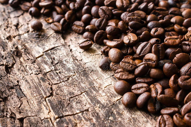 Roasted coffee beans on a wooden background. Close up stock photography