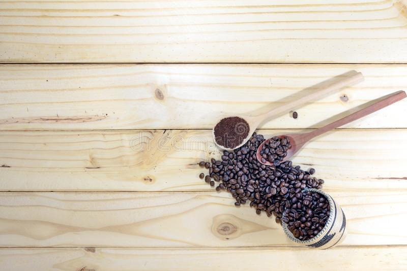 Roasted Coffee beans on wooden floor stock photography