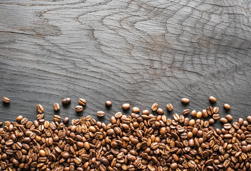 Roasted coffee beans on wooden table. Top view. stock image