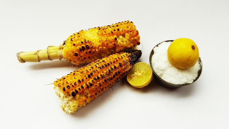 Roasted corn closeup image isolated on white background with lemon and salt. Alternative, ripe, nature, science, summer, growth, industry, plant, lifestyle royalty free stock photography