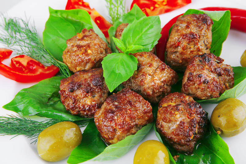 Download Roasted cutlets on basil stock photo. Image of green - 14960874