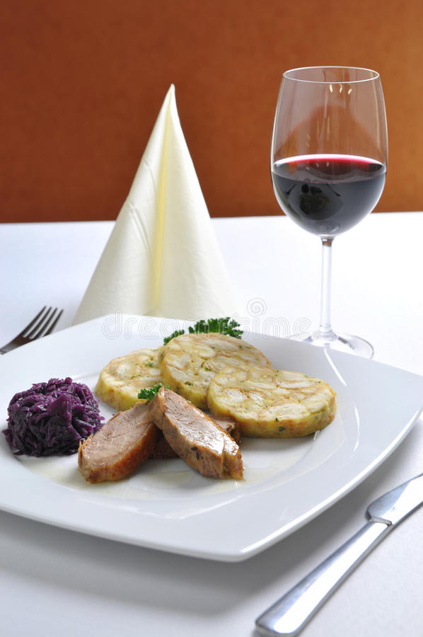 Roasted duck breast with Carlsbad dumplings. And red wine stock image