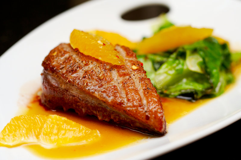 Roasted duck breast fillet. With miso-orange sauce and fried bokchoy stock images