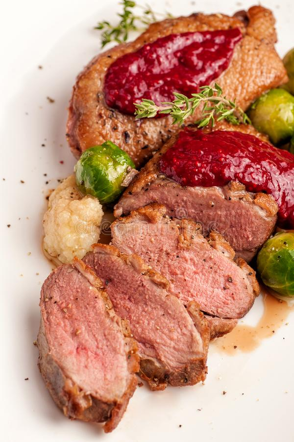 Roasted duck breast with vegetable garnish stock images