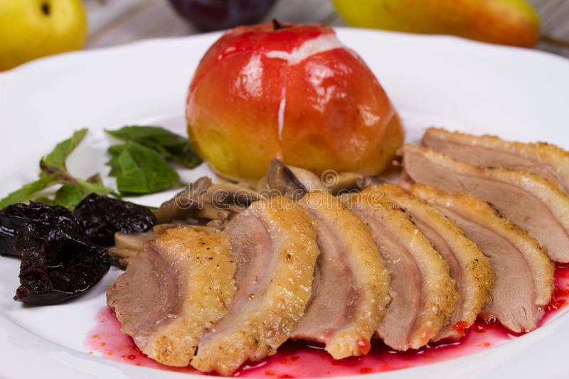 Roasted Duck Breasts with Mushroom, Apple and Plums Stuffing in Red Wine Sause. Roasted Duck Breasts with Mushroom, Apple and Plums Stuffing in Red Wine Sause royalty free stock photos
