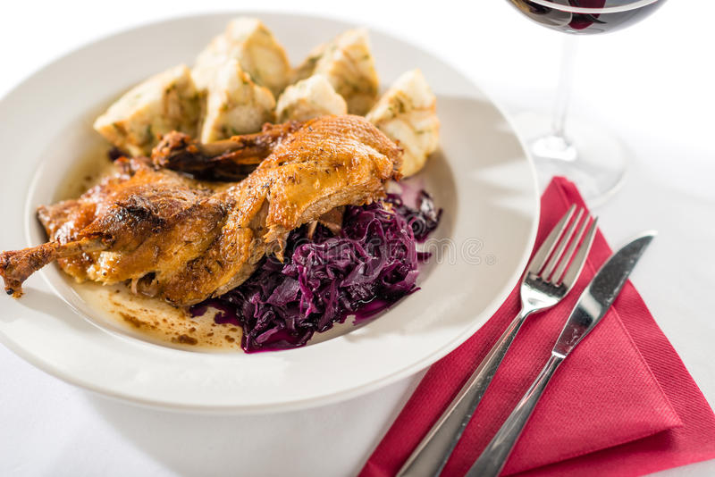 Roasted duck with cabbage and dumpling. Roasted duck with red cabbage and dumpling isolated on white royalty free stock photography