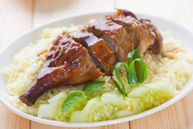 Roasted duck. Chinese style, served with steamed rice on dining table. Singapore cuisine royalty free stock photos