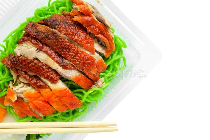 Roasted duck with jade noodle in plastic box and wooden chopsticks stock photo