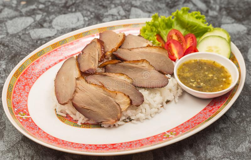 Roasted duck meat topping rice dressing sweet sauce and pickled ginger on plate stock photography