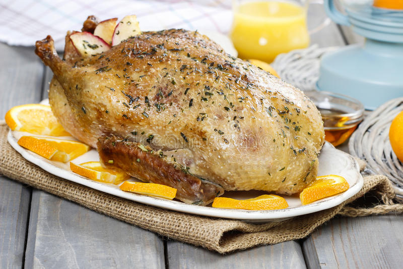Download Roasted Duck With Oranges On Wooden Table Stock Photo - Image: 38800979