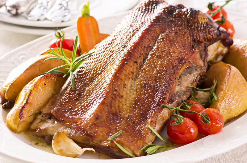 Roasted Duck with Potatoes stock photography
