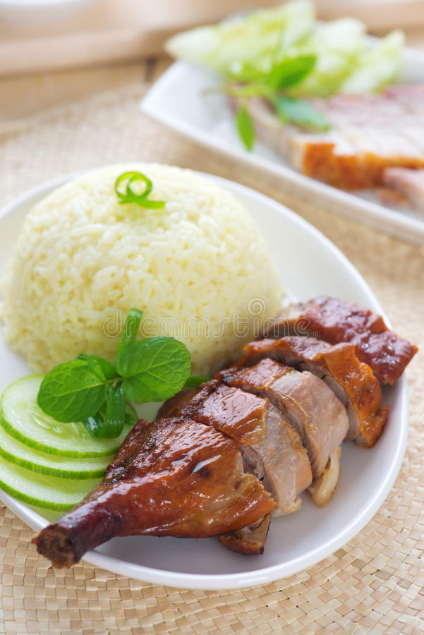 Roasted duck and roasted pork crispy siu yuk. Chinese style, served with steamed rice on dining table. Singapore cuisine royalty free stock images