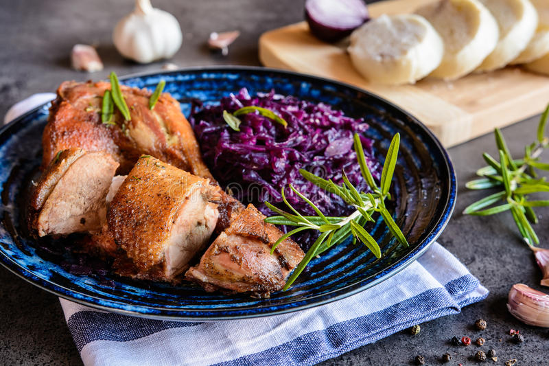 Roasted duck with stewed red cabbage and dumplings. Roasted duck leg and breast with stewed red cabbage and dumplings stock images