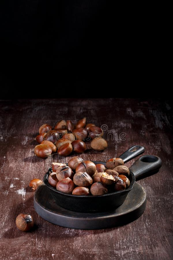 Roasted edible chestnuts stock photo