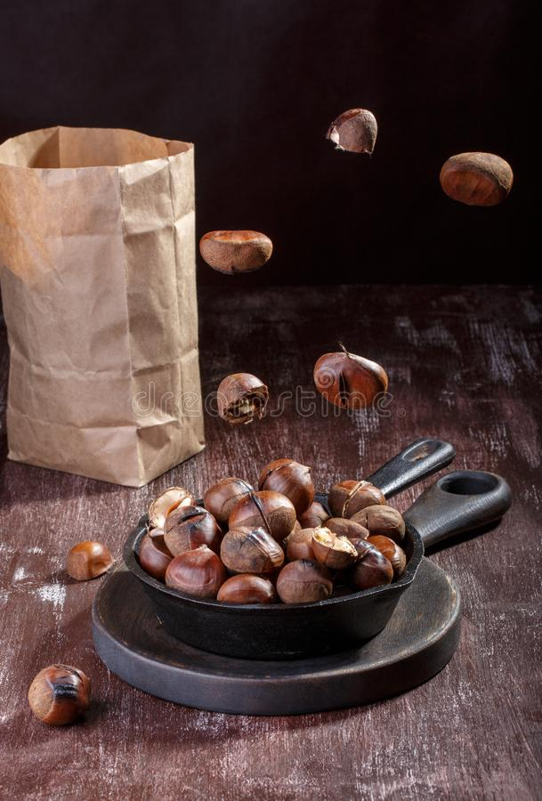 Roasted edible chestnuts stock photos