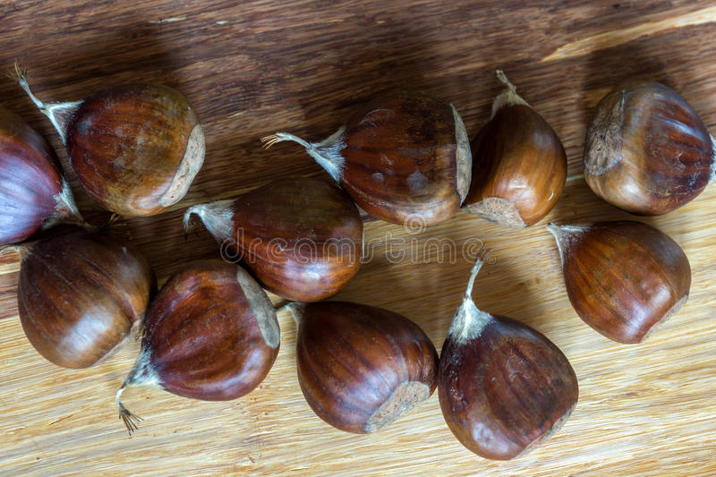Roasted edible sweet chestnuts stock photo