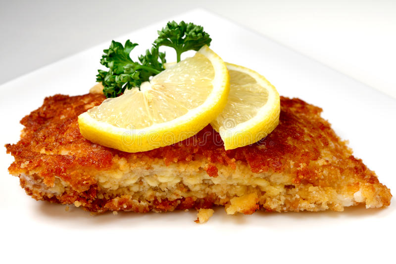 Roasted fish with lemon royalty free stock photography