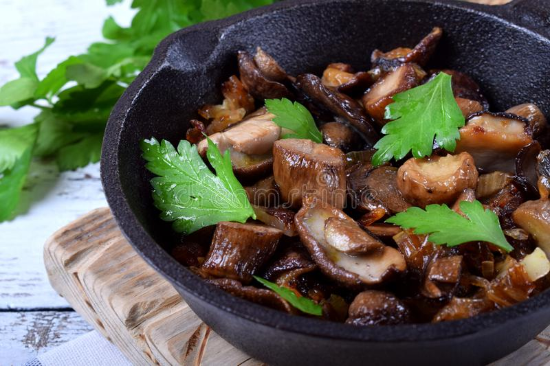 Roasted forest mushrooms topped with fresh parsley stock photo