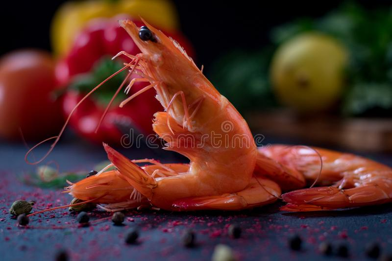 Roasted fried big shrimps in tomato oil, garlic, cilantro and soy sauce... Image royalty free stock images
