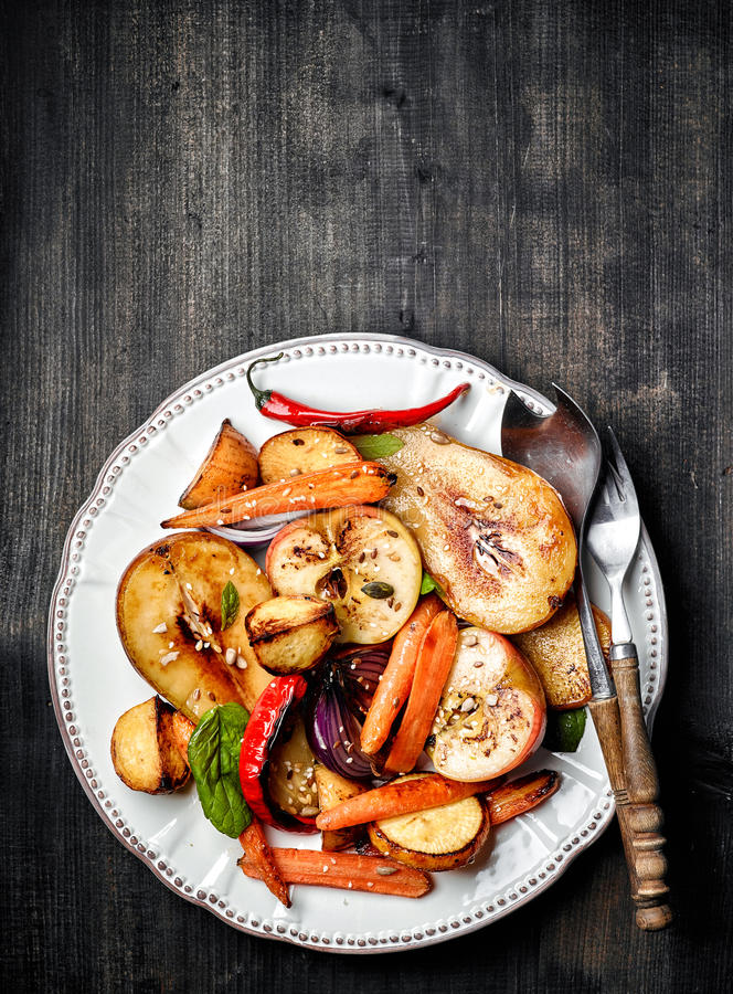 Roasted fruits and vegetables stock photography