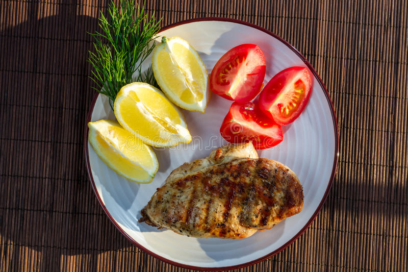 Roasted grilled chicken breast stock images