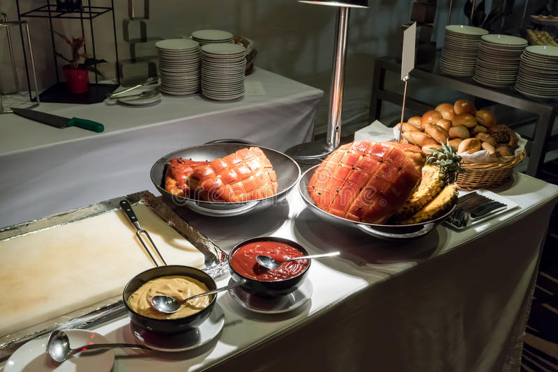 Roasted ham with honey glaze at meat carving station royalty free stock image