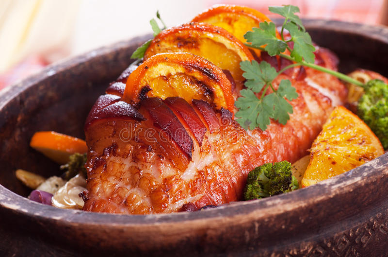 Roasted ham with vegetables royalty free stock photography