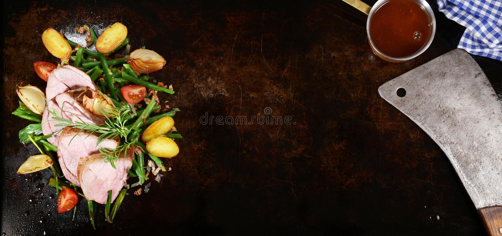 Roasted Lamb on green Beans with Potato stock photo